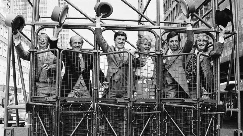 John McCririck (far right) with Graham Goode, John Oaksey, Brough Scott, Judith Chalmers and Derek Thompson in 1983