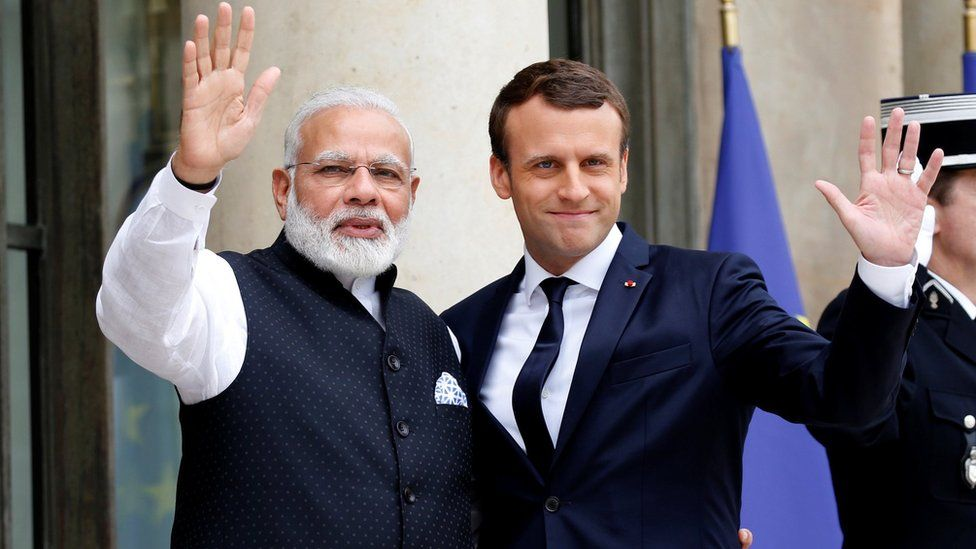 Indian Prime Minister Narendra Modi (L) is greeted by French President Emmanuel Macron (R) on the last leg of his four-nation visit at the Elysee palace in Paris, France, June 3, 2017