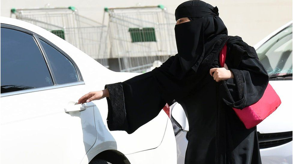 2014 file image of a Saudi woman wearing a niqab getting into a taxi at a mall in Riyadh