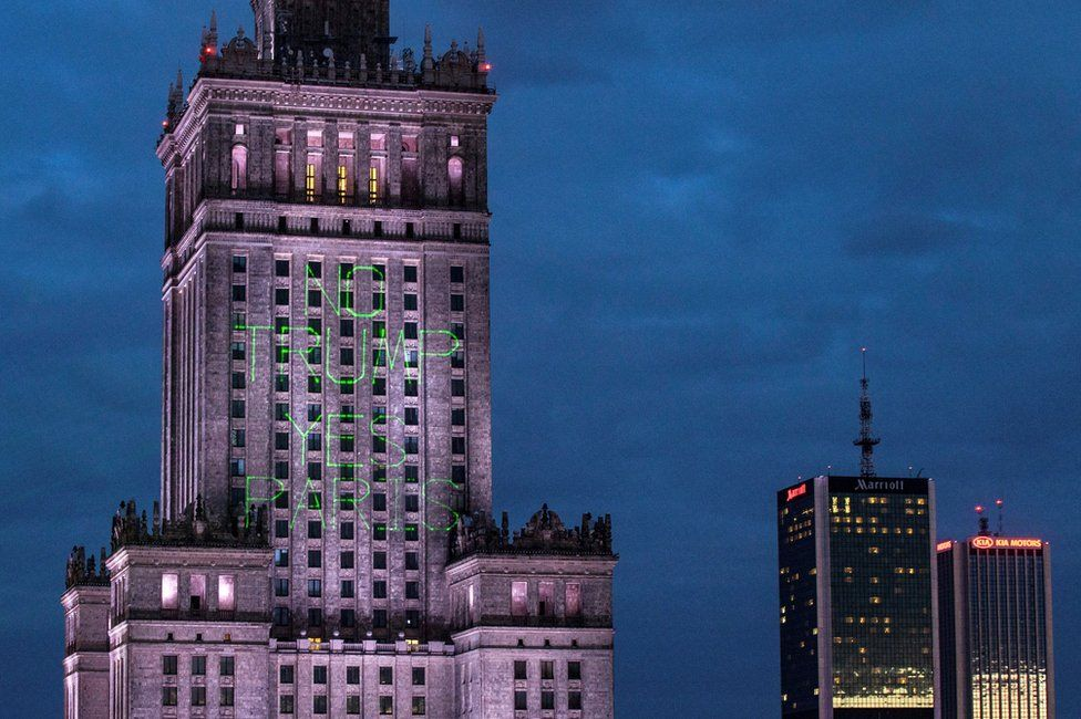 "Greenpeace activist illuminate the Palace of Culture and Science with words ""No Trump Yes Paris"" in Warsaw, Poland, 5 July"