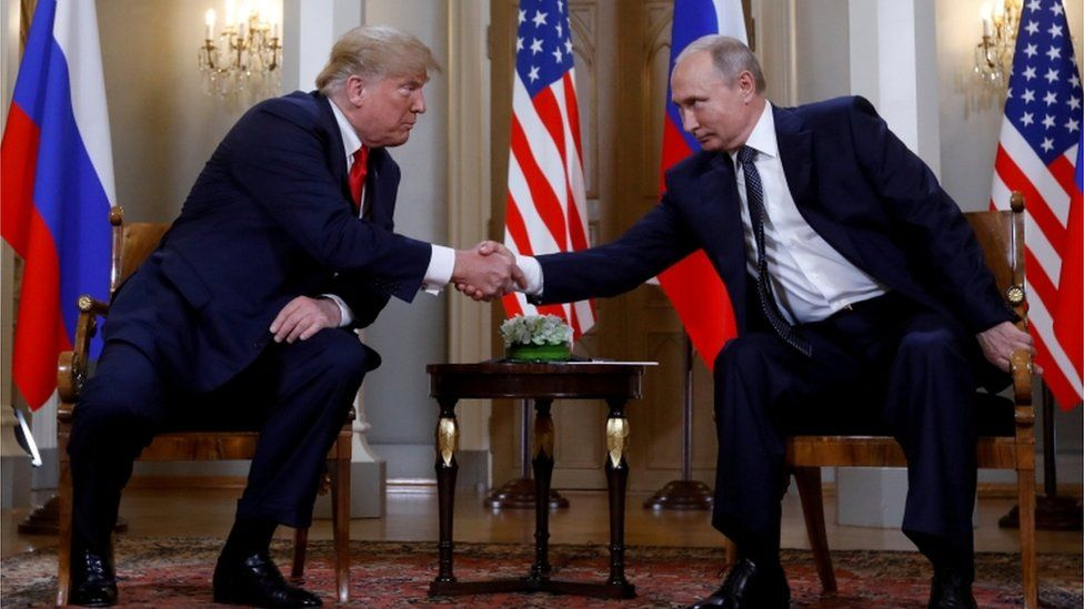Trump and Putin shake hands at the Helsinki summit