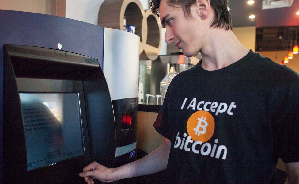 """Man wearing """"I accept Bitcoin"""" T-Shirt"""