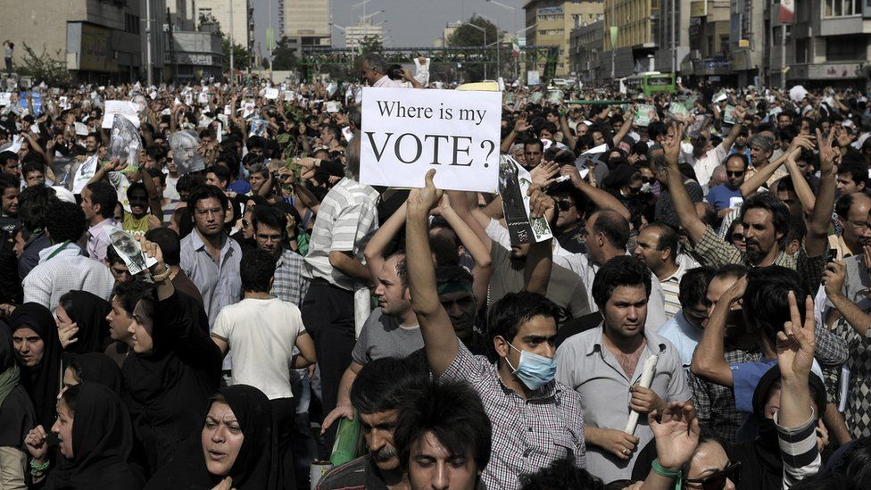 Iranian supporters of defeated presidential candidate Mir Hossein Mousavi march in Tehran on 15 June 2009