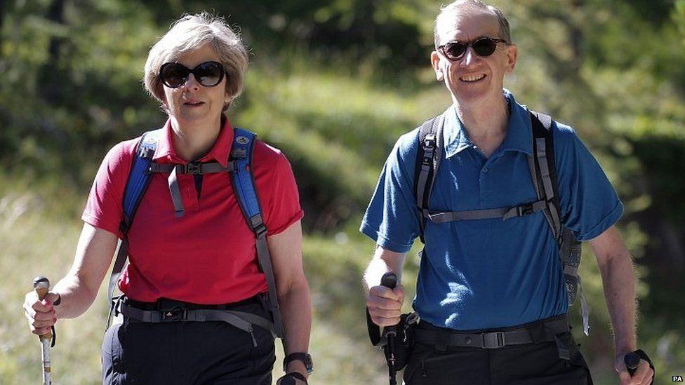 Theresa and Philip May walking in Switzerland