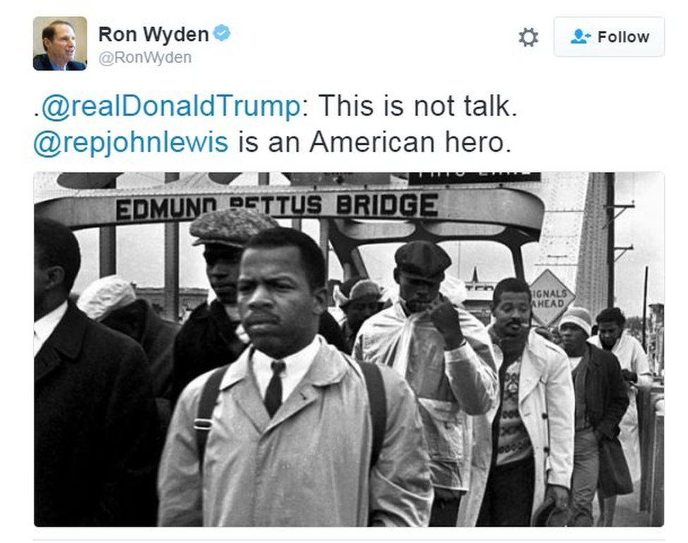 Tweet with photo showing Mr Lewis leading the Bloody Sunday march in Alabama