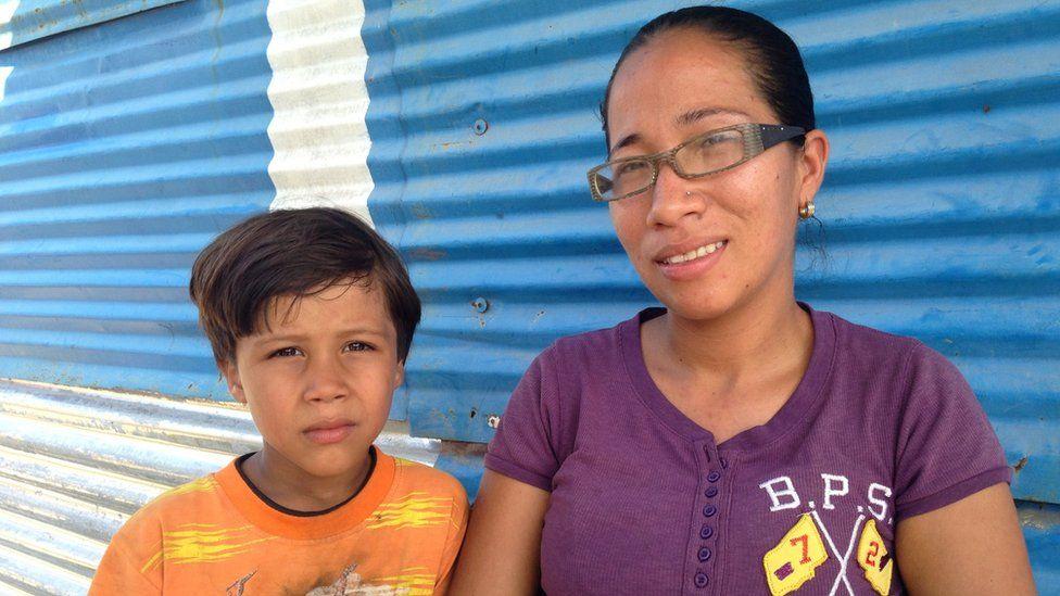 Darnellys Rodríguez with one of her children