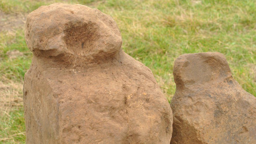 Two carved stones