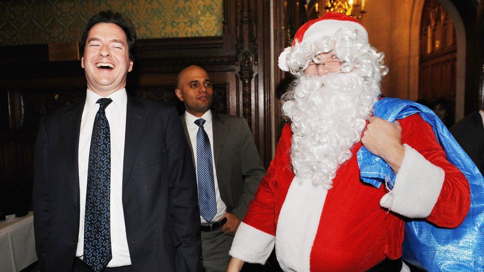 George Osborne with Ed Balls, who is dressed as Father Christmas
