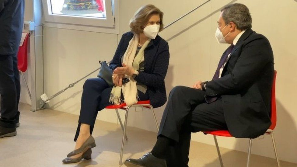 Mario Draghi and his wife Maria Serenella Cappello speak in a waiting room after receiving their first doses of the AstraZeneca jab