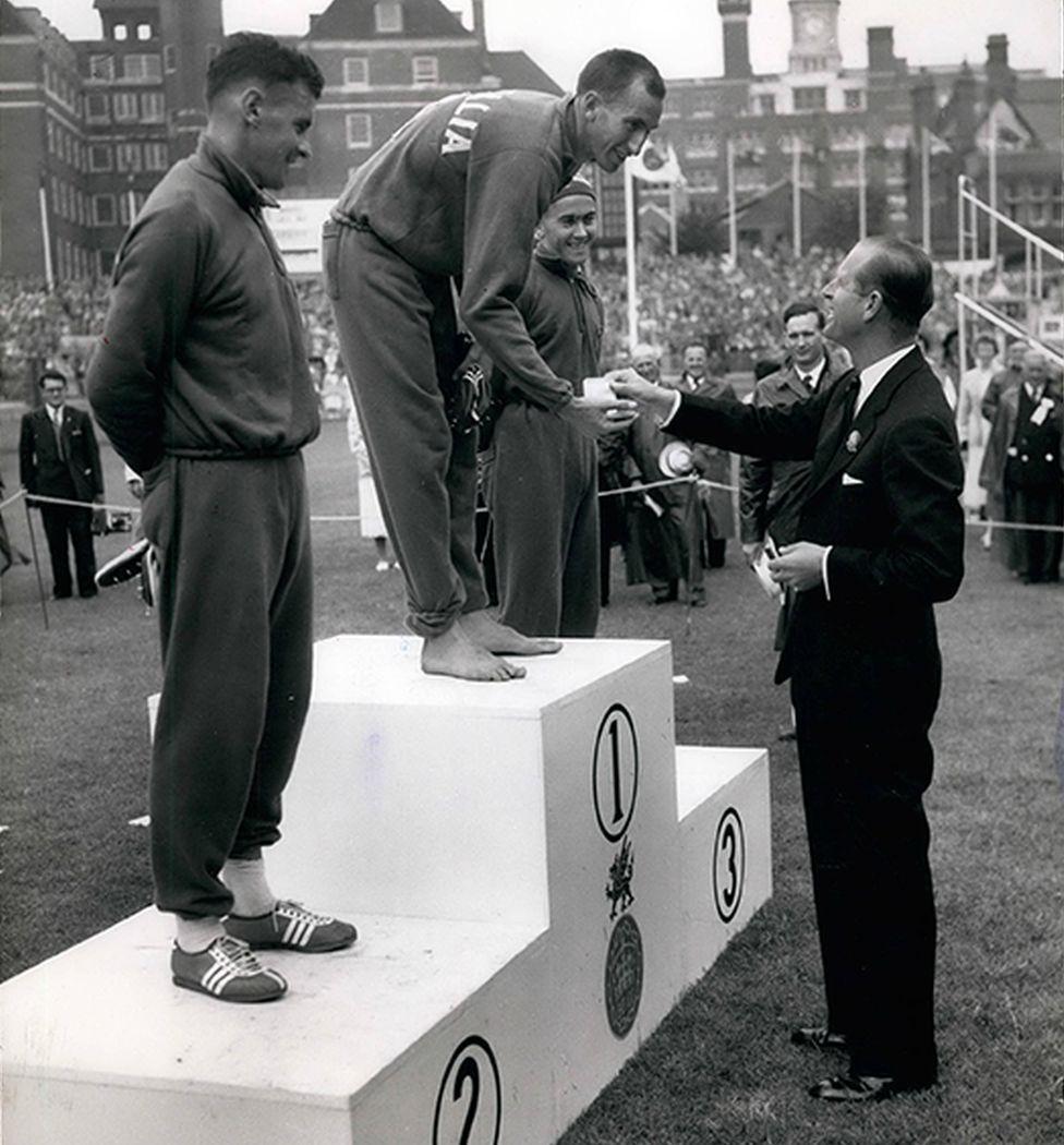 Final Day of Empire Games - the Duke of Edinburgh presenting the Gold Medal to Herb Elliott, of Australia