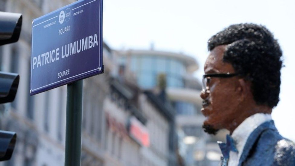 """A picture shows an effigy of Patrice Lumumba during the opening of """"Square Patrice Lumumba"""", the first public place in the former colonial power to honour late Congolese independence hero, on June 30, 2018 in Brussels. Lumumba was the first Prime Minister of the independent Congo after its independence from Belgium"""