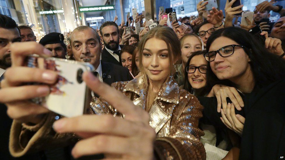 Gigi Hadid with some fans