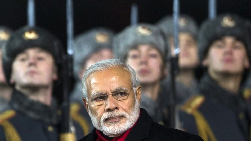 "Indian Prime Minister Narendra Modi, walks past an honour guard upon arrival at Moscow""s Government Vnukovo II Airport outside Moscow, Russia, Wednesday, Dec. 23, 2015"