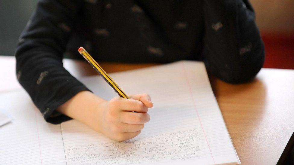 A pupil writing