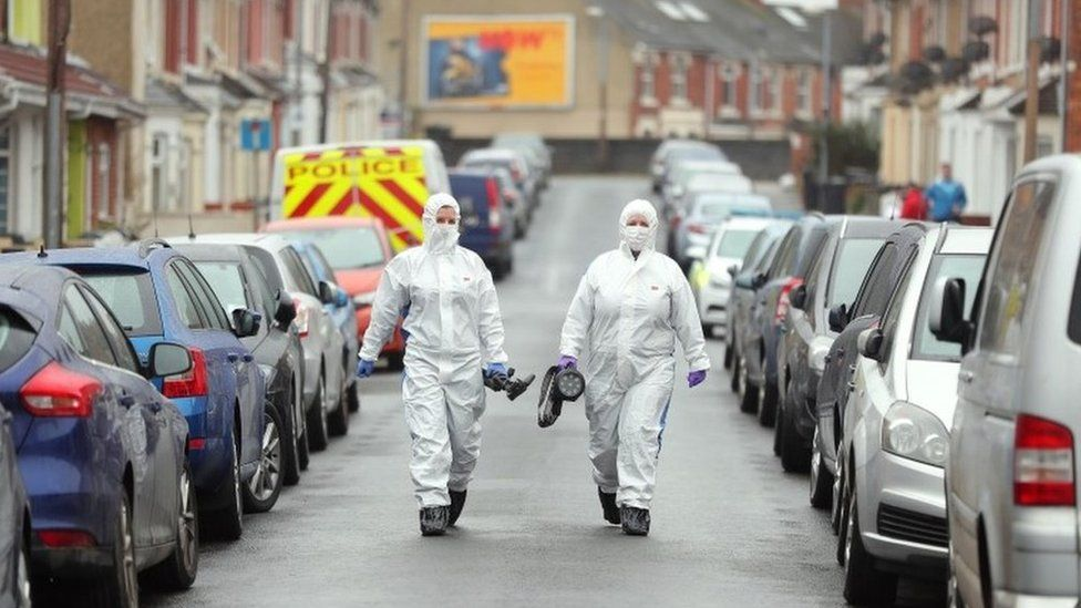 Forensic officers on nearby Graham Street, Swindon