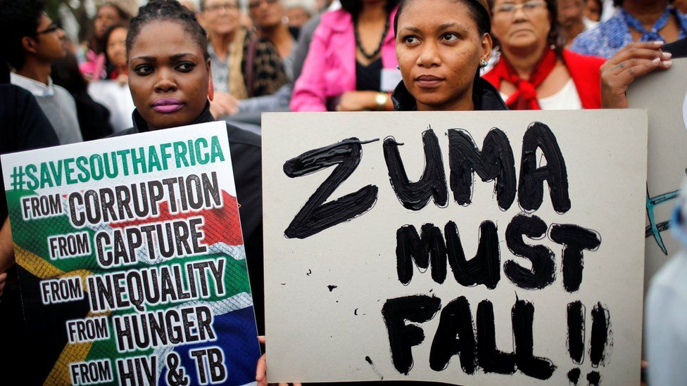 """Demonstrators protest against South African President Jacob Zuma""""s firing of Finance Minister Pravin Gordhan, outside Parliament in Cape Town, South Africa, March 31, 2017."""