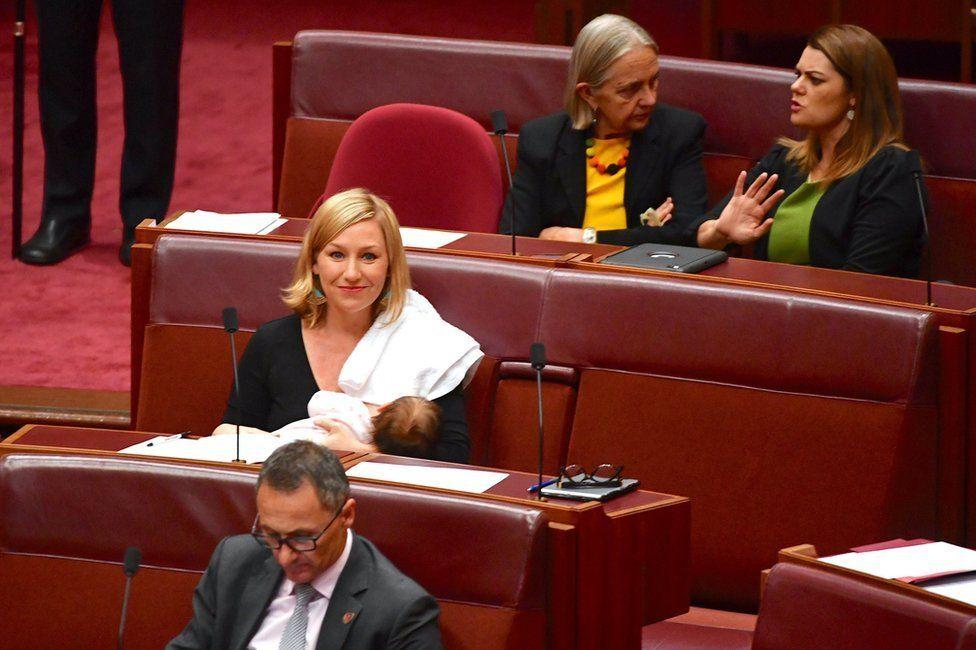 Senator Larissa Waters breastfeeds her daughter Alia Joy in Australian parliament.