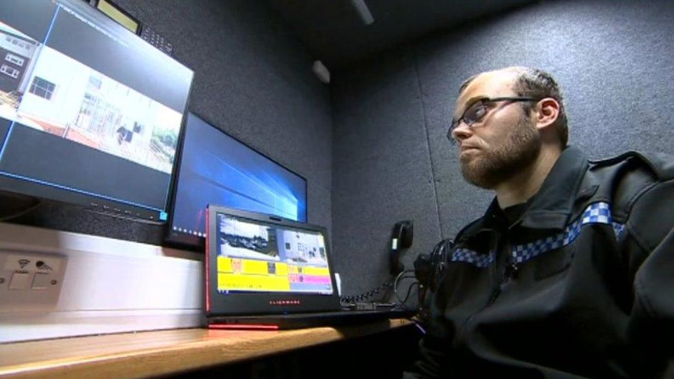 Police operating the system inside the van