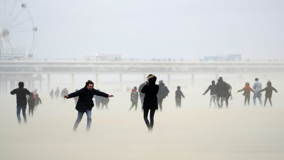 People on the beach at Scheveningen, the Netherlands, during Storm Ciara, 9 February 2020