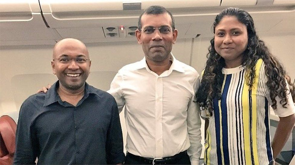 Nasheed (centre) with two members of his legal term