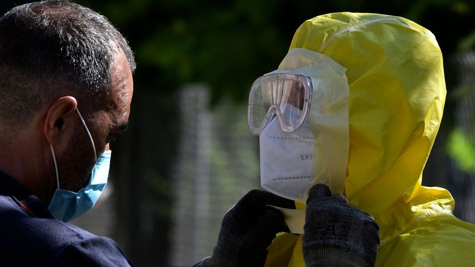 Firefighters prepare before disinfecting a nursing home for elderly people where more than 60 people tested positive for Covid-19 in Burbaguena, near Teruel on 4 August 2020