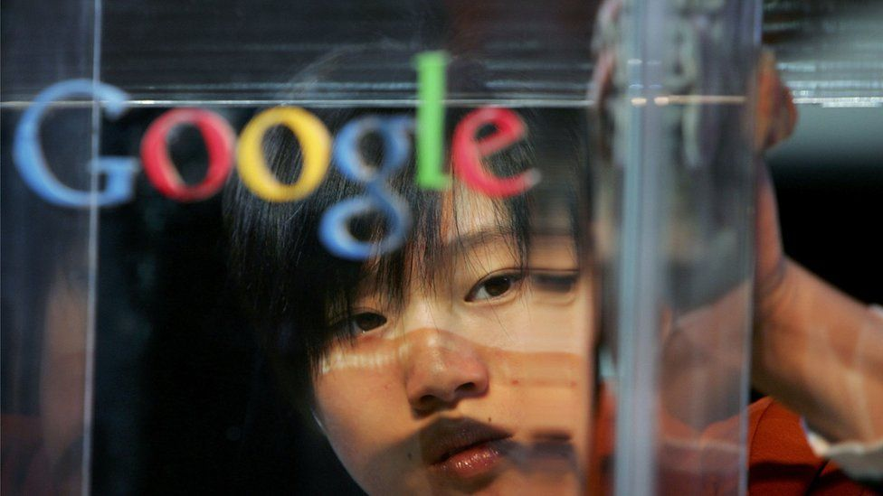 woman polishing Google sign