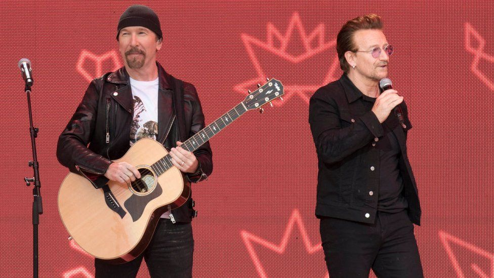 The Edge and Bono, of U2, performing on stage