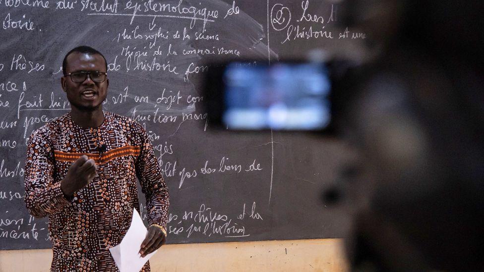 A philosophy teacher gives a philosophy class for final year high school students filmed by Burkina Info TV in Ouagadougou, Burkina Faso - Monday 30 March 2020