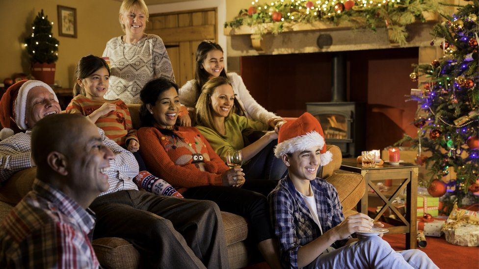 Family watching christmas telly