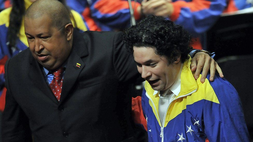 Hugo Chavez, late leader of Venezuela in 2011 with the director of the Simon Bolivar Youth Orchestra