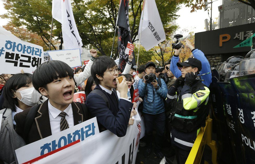South Korean high school students are blocked by police officers as they march toward the presidential house on 5 November, 2016
