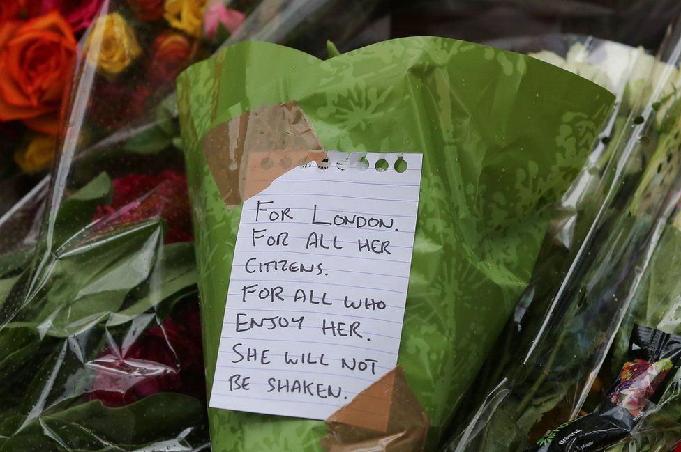 Flowers laid by the public on the ground near London Bridge station