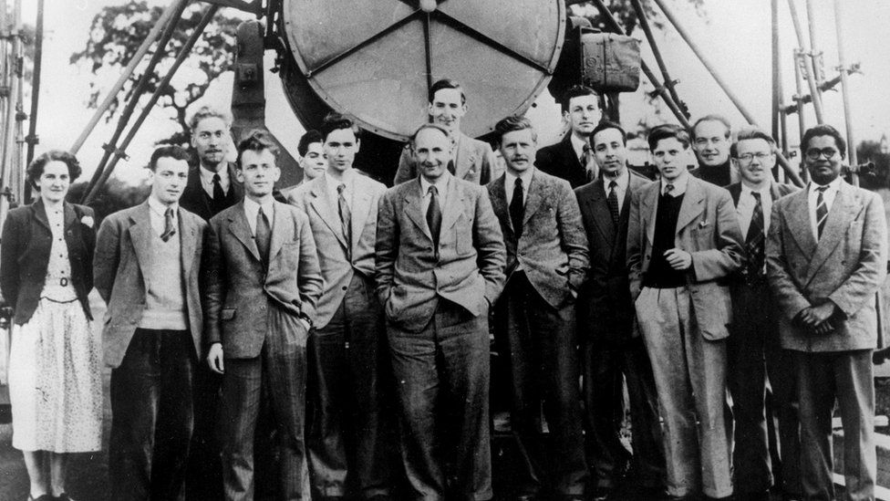Sir Bernard Lovell and the Jodrell Bank research team in front of the Searchlight Ariel