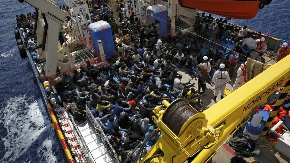 Exhausted migrants rest on the deck of the Migrant Offshore Aid Station (MOAS) ship Topaz Responder after being rescued around 20 nautical miles off the coast of Libya, June 23, 2016