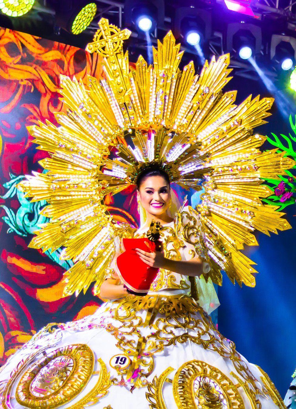 A woman in carnival dress