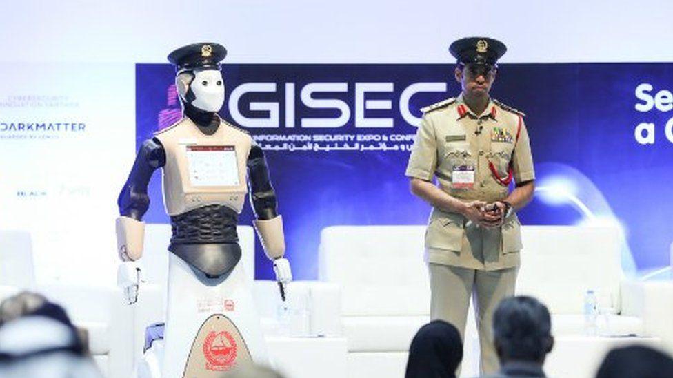 Robot officer with Dubai Police's Brigadier Al Razooqi