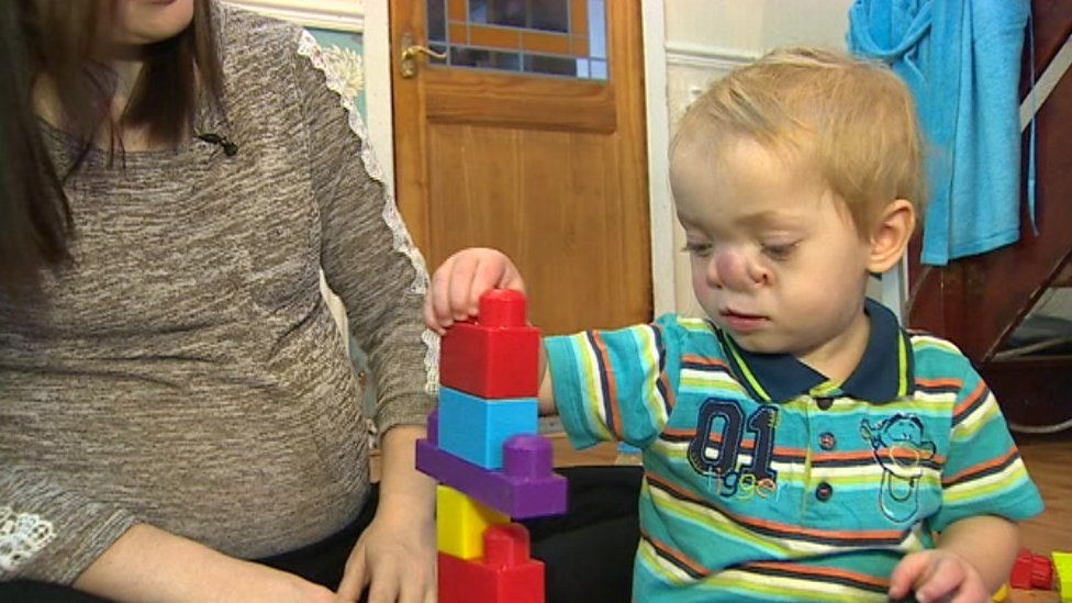Maesteg toddler Ollie playing with toy bricks