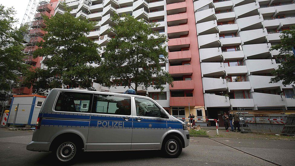 Police van at suspect's apartment block, Cologne, 14 Jun 18