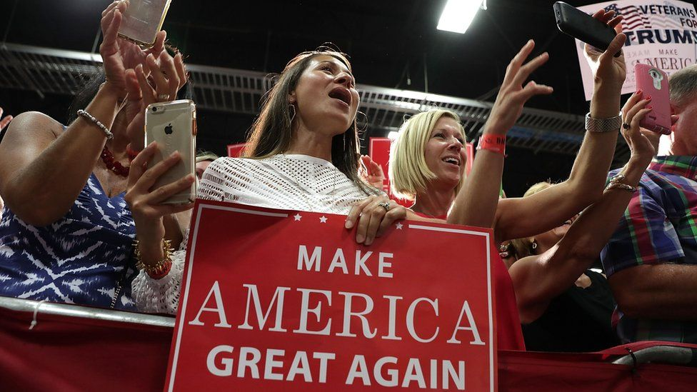 """Trump supporters hold up placards saying """"Mark America Great Again2 at a rally in Virginia, 20 August"""