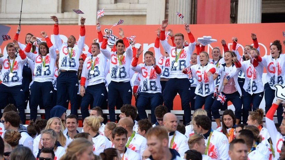 Team GB athletes start a Mexican wave on stage at Trafalgar Square