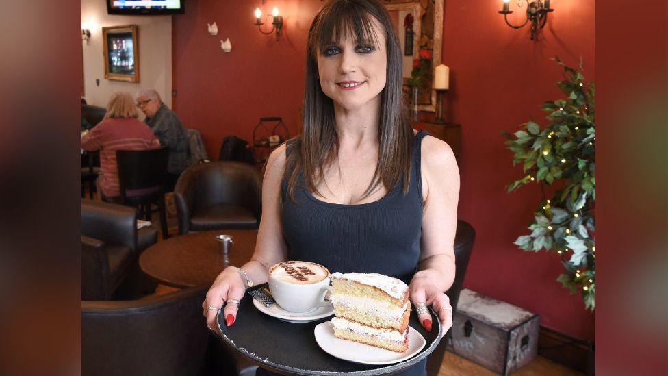 Sara Bailey with order at her Rhondda Cynon Taf café