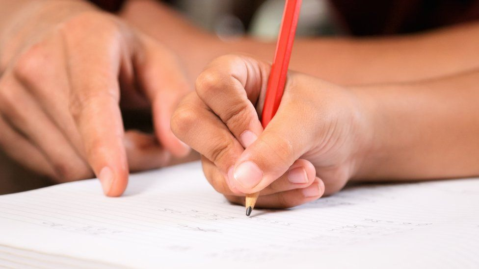 Teacher and student writing