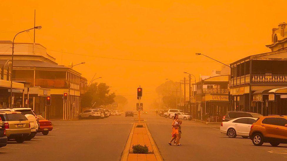 A main street in Broken Hill turned orange by a dust storm