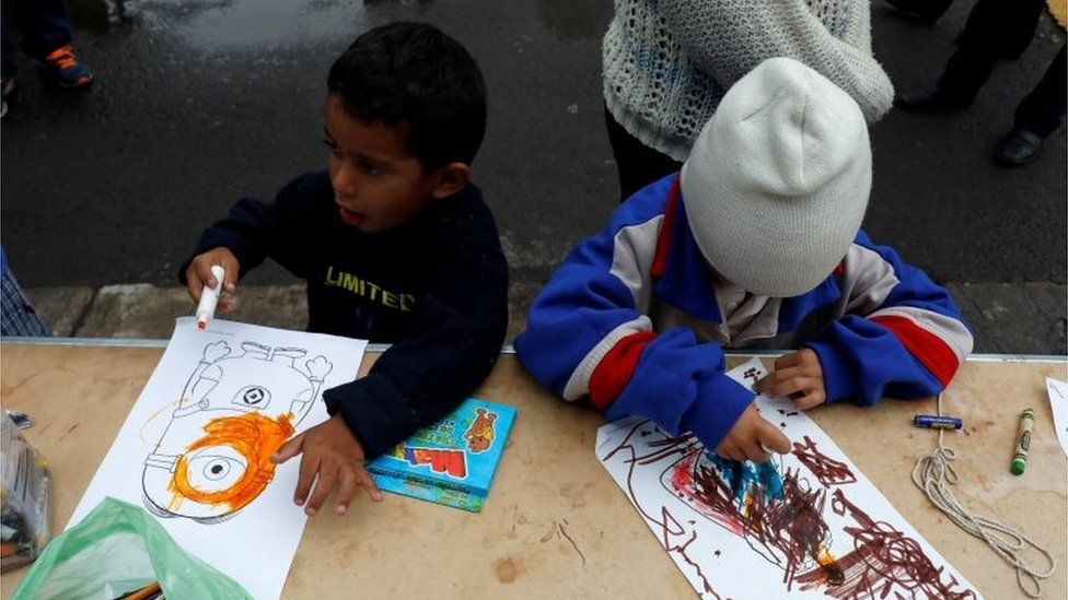 Children draw at a stadium in Mexico City