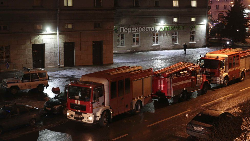 Vehicles of emergency services are parked near a supermarket after an explosion in St Petersburg, Russia 27 December 27