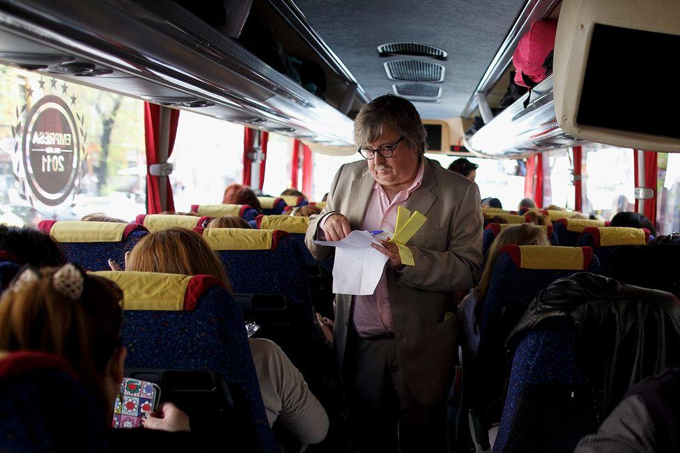 Manolo Gozalo checks tickets