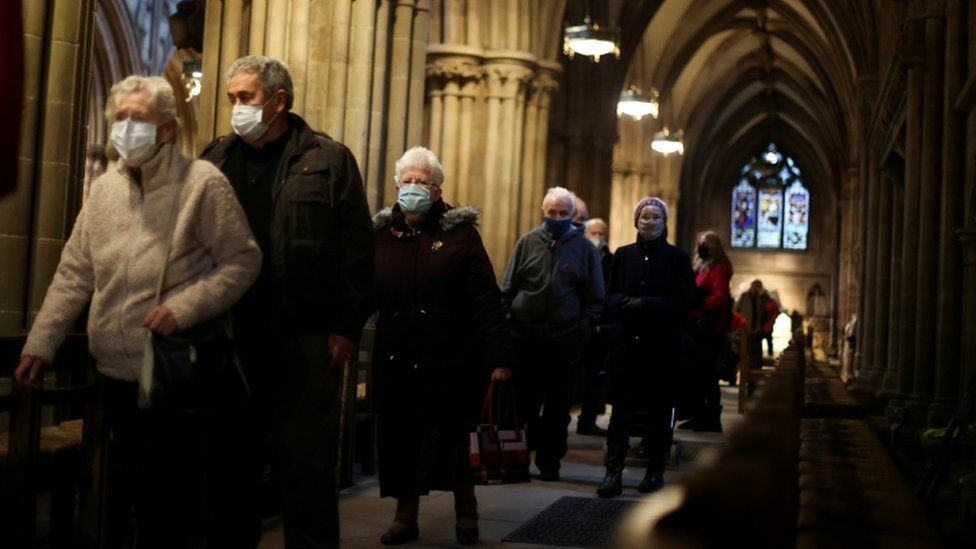 People queue to receive COVID 19 vaccines inside Lichfield Cathedral