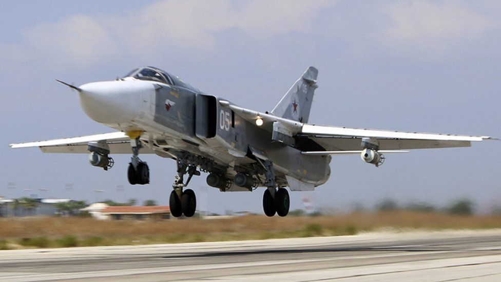 Russian Su-24M jet fighter armed with laser guided bombs takes off from a runaway at Hmeimim airbase in Syria.