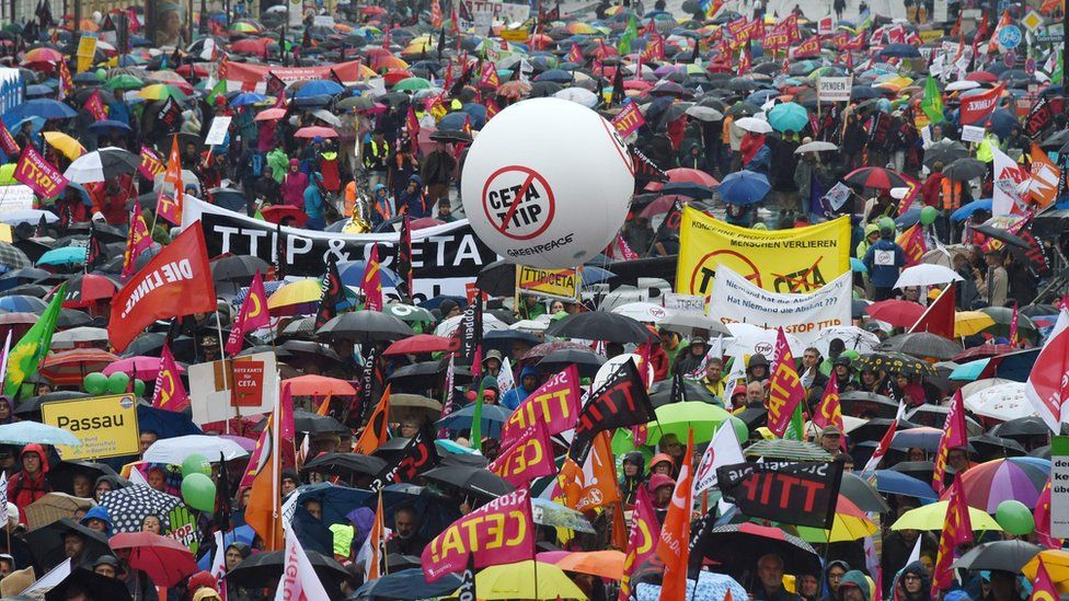 Demonstrators protest against the massive transatlantic trade deals CETA and TTIP on 17 September 2016 in Munich, southern Germany.