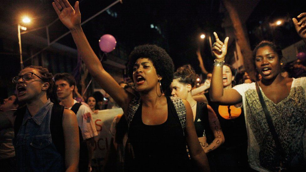 Activists and supporters chant during a march for women's rights on International Women's Day on 8 March 2016 in Rio de Janeiro, Brazil